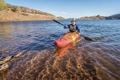 Paddling  kayak on mountain lake Royalty Free Stock Photo