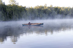 Paddling Through the Mist Stock Image