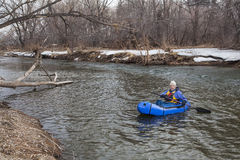 Paddling a packraft on a river stock photography