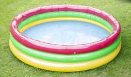 Paddling pool. With some water standing in the garden Royalty Free Stock Photography