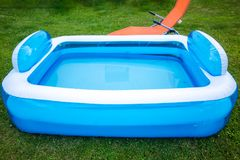 Paddling Pool. In summer on green meadow stock photos