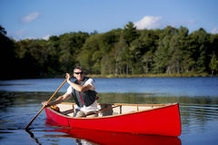 Paddling a Red Canoe - Canada Stock Images