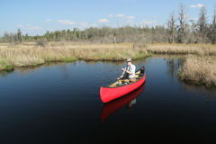Paddling a Red Canoe - Okefenokee Swamp, Georgia Stock Photo