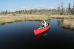 Paddling a Red Canoe - Okefenokee Swamp, Georgia stock photo
