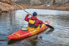 Paddling river kayak on calm water Stock Images