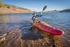 Paddling river kayak on lake Stock Photo