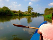 Paddling on a river Stock Photos
