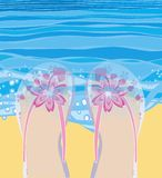 Paddling in the sea. Illustration of feet in pretty flip flops paddling in the sea with the water lapping over them could be used for greetings card Stock Photo