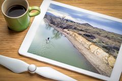 Stand up paddleboard on lake - aerial view. Paddling stand up paddleboard at dusk on a calm lake at foothills of Rocky Mountain in Colorado, reviewing an aerial Royalty Free Stock Images