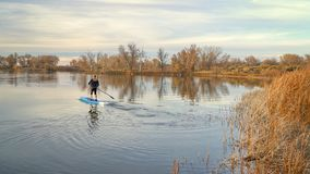 Paddling stand up paddleboard stock image
