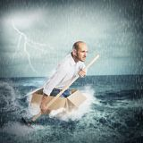Paddling in the storm Royalty Free Stock Photos