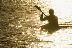 Paddling Into The Sunset Stock Photos