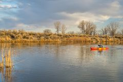 Kayak paddling on lake in early spring stock images