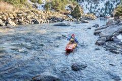 Paddling whitewater kayak Royalty Free Stock Photo