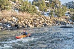 Paddling whitewater kayak Royalty Free Stock Image
