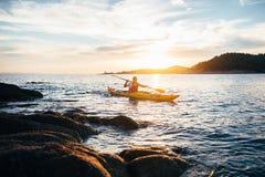 Free Paddling Yellow Sea Kayak At Sunset Sea Stock Photos - 167552723
