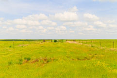 Paddock in the Flint Hills. Paddock without animals in the green pastures of the Flint Hills region in Kansas Royalty Free Stock Photos