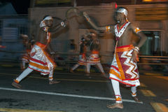Paddy Dancers perform along the streets of Kandy in Sri Lanka during the Esala Perahera. stock photos
