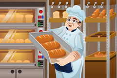 Padeiro Holding Breads Imagem de Stock