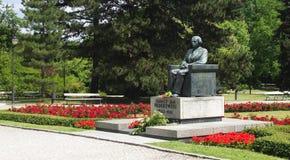 Paderewski monument 2. Ignacy Paderewski`s monument in Ujazdowski Park in Warsaw surrounded by greenery and flowers stock image