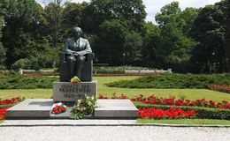 Paderewski monument 1. Ignacy Paderewski`s monument in Ujazdowski Park in Warsaw surrounded by greenery and flowers royalty free stock photo