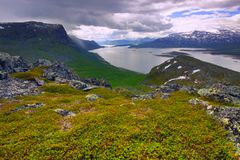 Padjelanta national park. Mountain covered with snow in padjelanta national park in sweden with lake Stock Image