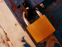 Padlock. On a rusty background Stock Photo