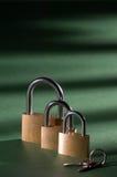 Padlock 10. Bronze padlock close up with silver handle 10 Stock Photo
