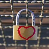 Padlock. On the fence with a heart Royalty Free Stock Photography