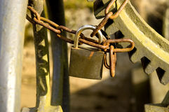 Padlock. Locking an old gear machinery with a rusty chain. With space for copy stock images