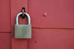 Padlock. On red metal door Royalty Free Stock Photography