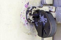 Padlock. On distressed paintwork door Stock Photos