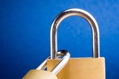 Padlock 4. Bronze padlock close up with silver handle 4 Stock Image