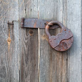 Padlock. Rusty old padlock on a wooden fence stock images