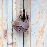 Padlock. Rusty old padlock on a metal door Stock Photo