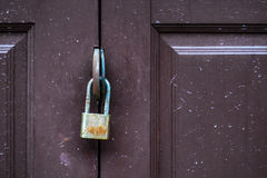 Padlock on an ancient door. Closed up of old padlock on an ancient door Stock Photos