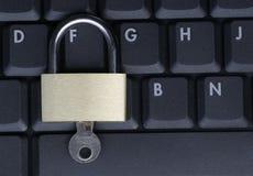 Padlock On Black Laptop Keyboard. Closed Padlock On A Black Laptop Keyboard, IT Security Concept royalty free stock photos