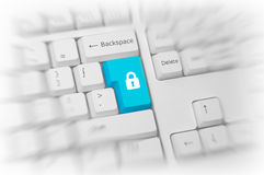 Padlock on a blue computer key Royalty Free Stock Photography