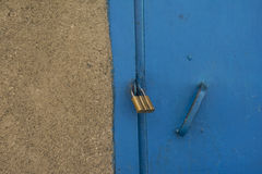 Padlock on a blue door Stock Photography