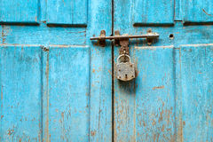 Padlock on a blue door Stock Image
