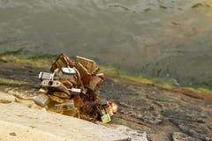 Padlock on the bridge. Lot hinged barn locks on the wall above the river, padlock on the bridge Stock Image