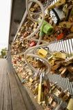 Padlock on the bridge. Lot hinged barn locks on the wall above the river, padlock on the bridge Royalty Free Stock Photos