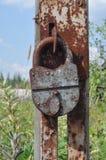 Padlock on an broken gate Royalty Free Stock Image