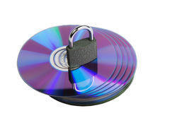 Padlock on CD disks isolated over white background Stock Photo