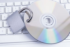 Padlock with CD and Keyboard Royalty Free Stock Photos