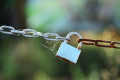 Padlock on chain Stock Photo