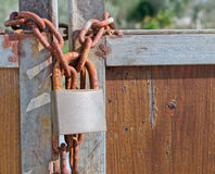 Padlock and chain. Rusty padlock and chain on an old gate Stock Photography