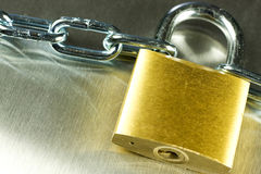 Padlock with Chain. Strong Security Lock & Chain on a metal background Stock Image