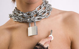 Padlock and chain around young female neck Stock Image