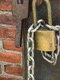 Locked up. Padlock Chain Bricks Inside looking Stock Images